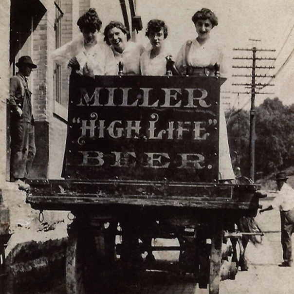 Womens over an Miller High Life ad